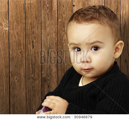 portrait of a handsome boy against a wooden background