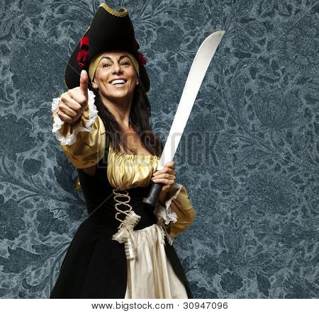 portrait of a pirate woman holding a sword and gesturing an ok symbol against a vintage background