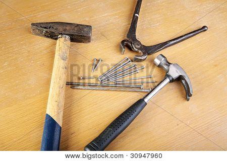 Two Hammers And Pincers With Nails