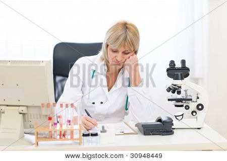 Bored Senior Doctor Woman Working At Office