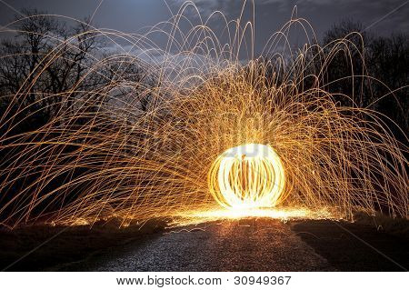 Abstract Image of Burning Wirewool being used to make orb like light trails at Night