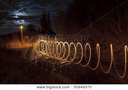 Abstract Image of Burning Wirewool being used to make tunnel like light trails at Night