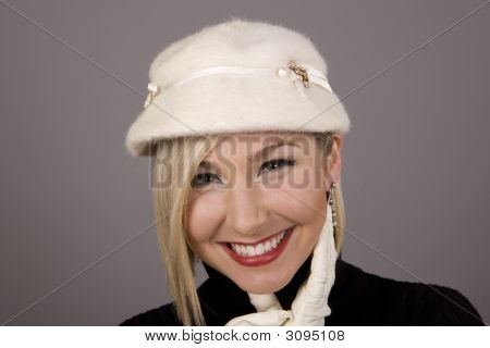 Blonde In Fur Hat Laughing Hand On Chin