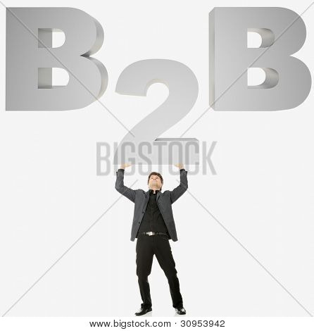 Businessman holding big 2 from B2B sign.