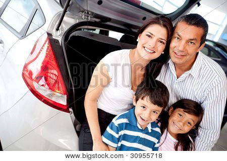 Family at the dealer buying a new car