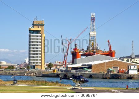 Helicopter Lands Near Oil Rig In The Bay