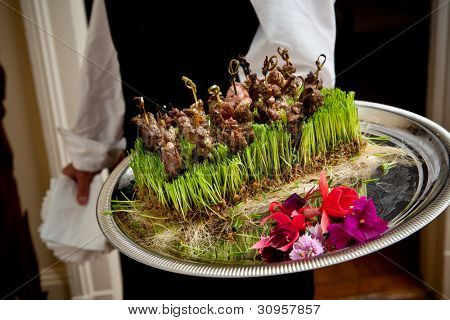 Appetizers being served at a wedding event