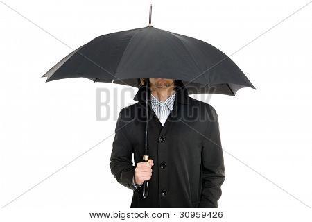 elegant business man in a raincoat standing under an umbrella.