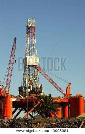 Oil-Rig In Harbor Against Blue Sky