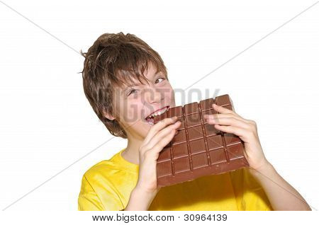 Happy Young Man Eating Chocolate