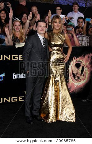 """LOS ANGELES - MAR 12:  Josh Hutcherson; Jennifer Lawrence arrives at the """"Hunger Games"""" Premiere at the Nokia Theater at LA Live on March 12, 2012 in Los Angeles, CA"""