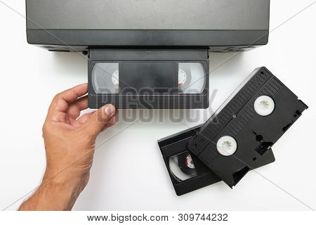 poster of High Angle Shot On Video Tape Inserted In Vcr. Cctv Tape Recorder. Black Video Cassette Vhs Type Loa