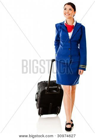 Air hostess walking with her bag - isolated over a white background