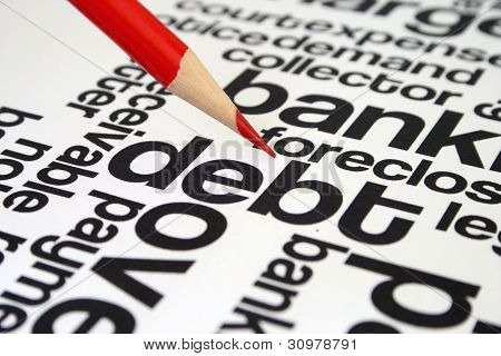 Close up of pen on  Debt Word Cloud