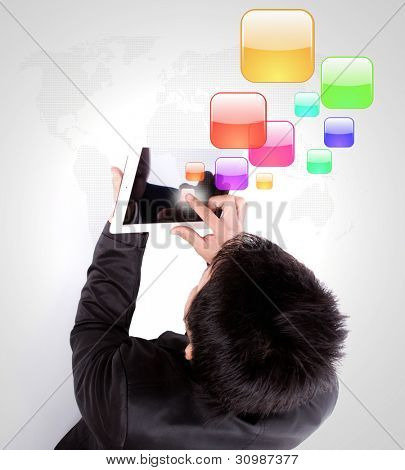 Business man using a touch screen device with colorful application icons