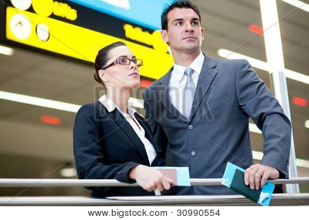 determined business travellers in airport