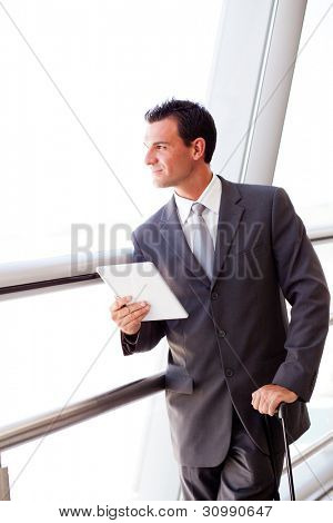 businessman using tablet computer at airport