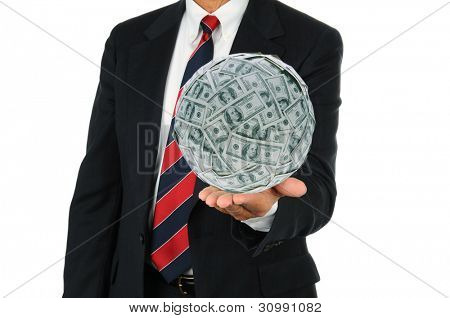 Businessman holding a large ball of money in the palm of his hand. Man is unrecognizable, wearing a suit and tie over a white background.