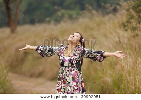 happy asian woman breathing in nature, thailand