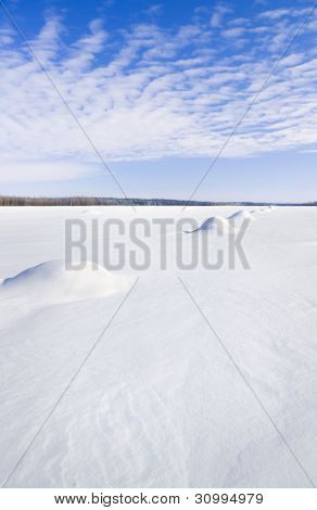 Snow Field In Sunny Day.