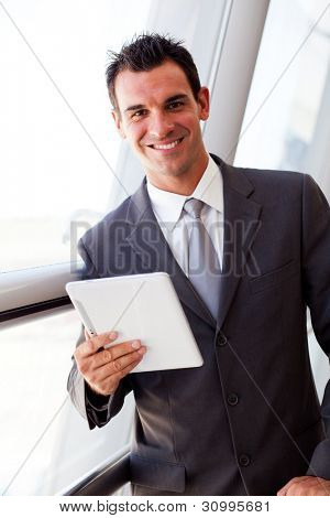 handsome young businessman using tablet computer
