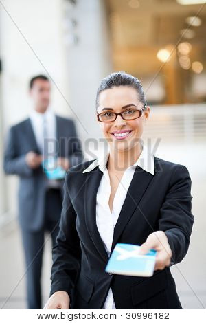 beautiful businesswoman handing over air ticket at airport