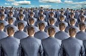 stock photo of people work  - Rear view of many identical businessmen clones - JPG