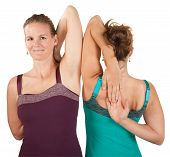 stock photo of shoulder-blade  - Two women stretch their shoulders over white background - JPG