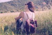 Traveler Girl Relaxing In Meadow In Vacation. Young Girl Traveler Relaxing In Nature. Traveler With  poster