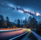 Milky Way Over Mountain Road. Blurred Car Headlights On Winding Road In Autumn. Colorful Night Lands poster