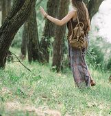 Attractive Hippie Girl Walking On A Forest Path poster
