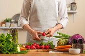 Chef Cuts Fresh Radish For Salad. The Concept Of Losing Healthy And Wholesome Food, Detox, Vegan Eat poster