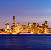 San Francisco downtown skyline at dusk from Treasure Island, California, sunset, USA. poster