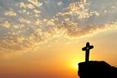 Silhouette Of Jesus Christ Crucifix On Cross Over Sunset.concept For Catholic Religion, Christian Wo poster