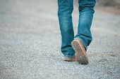 Feet Walking Of Lonely Man,step By Step On The Street.picture Of Journey Person Wearing Jean And Fas poster