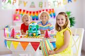 Child Birthday Party. Kids Blow Candle On Cake. poster