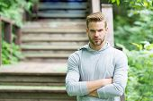 Muscular And Confident. Muscular Man On Summer Day. Athletic Guy Keeping Muscular Arms Crossed At Pa poster