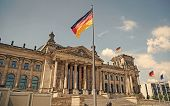 German Flags Waving In The Wind At Famous Reichstag Building, Seat Of The German Parliament Deutsche poster
