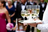stock photo of waiter  - beverages being served by a waiter - JPG