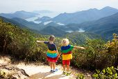 Family Hiking In Hong Kong Mountains poster