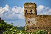 Ancient Ruins Of Stare Selo Castle, Brick Wall  Against The Blue Cloudy Sky. Fortress In Stare Selo, poster