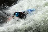 stock photo of kayak  - Kayaker is swamped by raging whitewater on a river in North Carolina - JPG