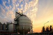 Gas Storage Sphere Tanks And Pipeline In Petrochemical Industrial Plant On Sky Sunset Background, Ma poster