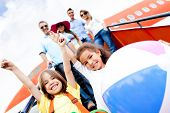 picture of family vacations  - Happy kids traveling by airplane for their vacations - JPG