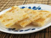 stock photo of taro corms  - Taro cakes are a common dim sum dish in Chinese culture - JPG