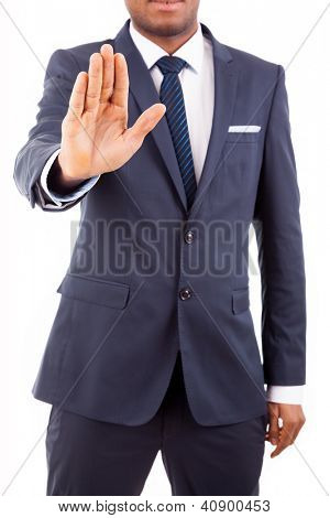 Young businessman making stop sign with hand, isolated on white