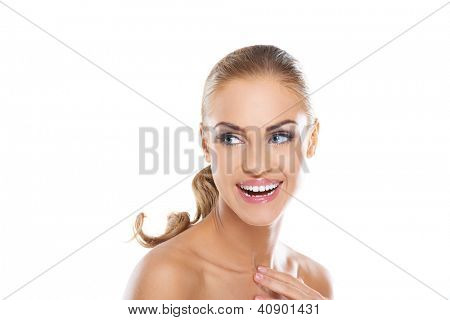 Beautiful young vivacious blonde woman full of vitality laughing a she glances back over her shoulder, head and shoulders studio portrait on white
