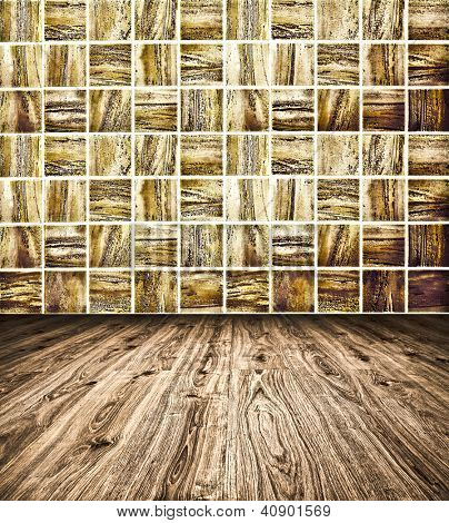 Background of Golden Mosaic Texture and wooden floor, spacious vintage room with stone and glass tiled grungy wall
