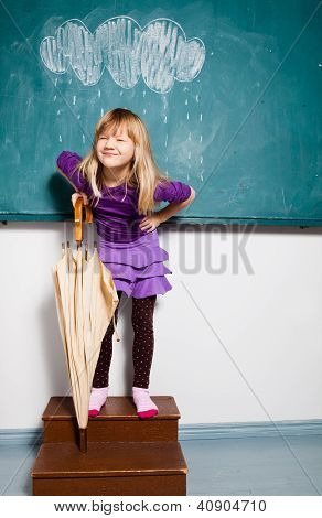 Smiling Young Girl With Umbrella Indoors