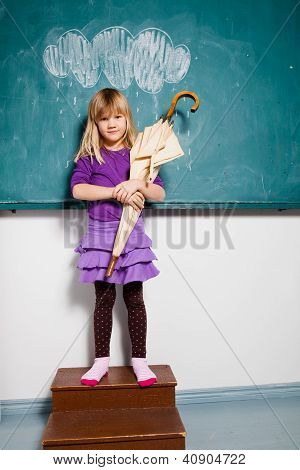 Young Girl Holding Umbrella Indoors